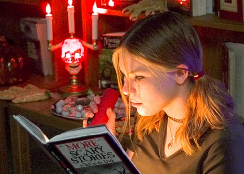 Picture-of-girl-reading-scary-stories