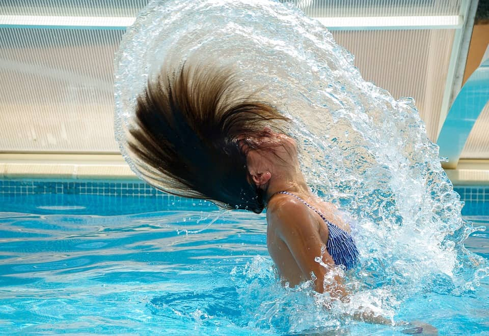 Woman-in-pool-flipping-hair