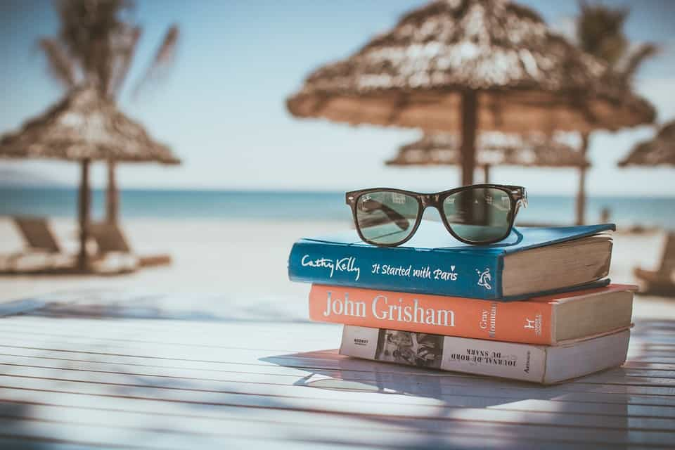 stack-of-books-on-a-beach